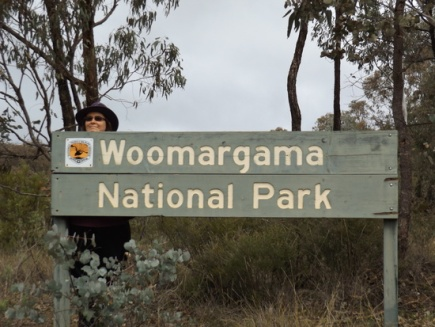 Rebecca hiding behind the Woomargama NP sign